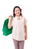 Happy middle aged woman with shopping bag Royalty Free Stock Photos