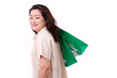 Happy middle aged woman with shopping bag Stock Photos