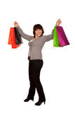 Happy middle-aged woman with shopping bag. Isolated on white Royalty Free Stock Images