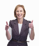 Happy middle aged woman showing a thumbs up sign Stock Photo