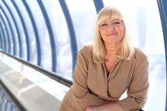 Happy middleaged businesswoman near glass wall Royalty Free Stock Photography