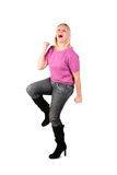 Happy middleaged woman  stands dancin Royalty Free Stock Image