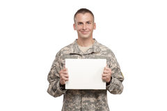 A smiling soldier holds a blank white sign Stock Photography