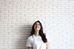 Happy millennial girl having fun indoors. Portrait of young woman with diastema gap between teeth. Beautiful smile. Minimalistic i royalty free stock images