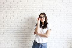 Happy millennial girl having fun indoors. Portrait of young woman with diastema gap between teeth. Beautiful smile. Minimalistic i stock images