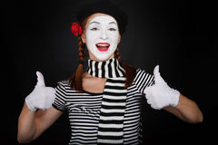 Happy mime comedian showing thumbs up stock photography