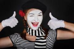 Happy mime portrait. Portrait of a sad mime comedian,on black background Stock Images