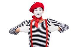 Happy mime showing thumbs up. Isolated on white royalty free stock image