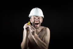 Happy  miner shows a golden nugget Stock Photos