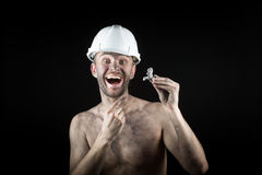 Happy  miner shows a silver nugget Royalty Free Stock Images