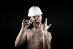 Happy  miner shows a silver nugget Royalty Free Stock Photos