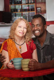 Happy Mixed Couple in Coffeehouse royalty free stock image