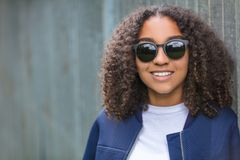 Happy Mixed Race African American Teenager Woman In Sunglasses. Beautiful happy mixed race African American girl teenager female young woman outside wearing Royalty Free Stock Photography