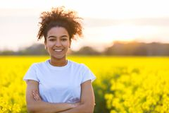 Happy Mixed Race African American Teenager Woman Yellow Flowers Royalty Free Stock Photography