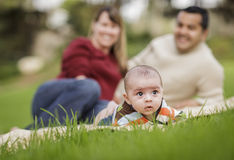 Happy Mixed Race Baby Boy and Parents Playing in Park Stock Image