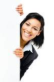 Happy mixed race business woman pointing at empty copy space iso Stock Photo