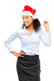 Happy mixed race businesswoman wearing Christmas hat isolated on Royalty Free Stock Image