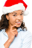 Happy mixed race businesswoman wearing Christmas hat isolated on Stock Photo