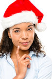 Happy mixed race businesswoman wearing Christmas hat isolated on Stock Image