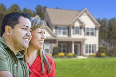 Happy Mixed Race Couple in Front of House Royalty Free Stock Photography