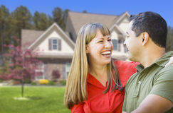Happy Mixed Race Couple in Front of House. Happy Mixed Race Couple in Front of Beautiful House stock photography