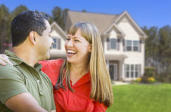 Happy Mixed Race Couple in Front of House Royalty Free Stock Images