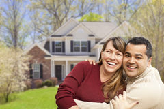Happy Mixed Race Couple in Front of House Royalty Free Stock Photos