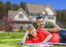 Happy Mixed Race Couple in Front of House Stock Photo