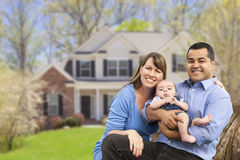 Happy Mixed Race Couple in Front of House Stock Photos
