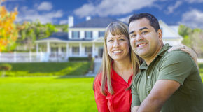 Happy Mixed Race Couple in Front of House Stock Image
