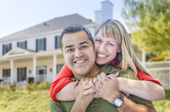Happy Mixed Race Couple in Front of House. Happy Mixed Race Couple in Front of Beautiful House stock images