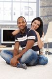 Happy mixed race couple at home Royalty Free Stock Photography