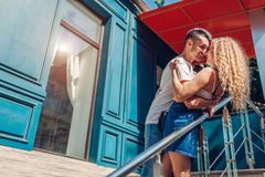 Mixed race couple in love walking in city. Arab man and his white girlfriend hugging on stairs. Romantic date stock images