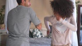 Happy couple dancing in bedroom