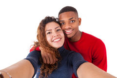 Happy mixed race couple taking a selfie photo over a white background stock photos