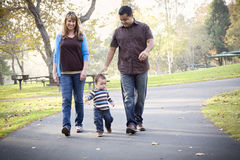 Happy Mixed Race Ethnic Family Walking Stock Photo