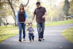 Happy Mixed Race Ethnic Family Walking Stock Photo