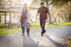 Happy Mixed Race Ethnic Family Walking In The Park Stock Photos