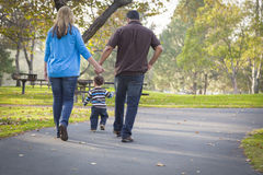 Happy Mixed Race Ethnic Family Walking In The Park Royalty Free Stock Photos