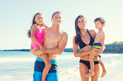 Happy Mixed Race Family on the Beach Stock Photography