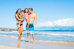 Happy Mixed Race Family on the Beach Stock Images