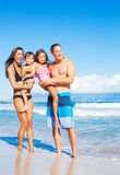 Happy Mixed Race Family on the Beach Royalty Free Stock Images