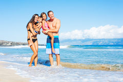 Happy Mixed Race Family on the Beach Royalty Free Stock Photo