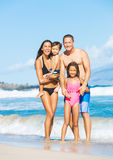 Happy Mixed Race Family on the Beach Royalty Free Stock Photography