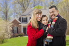 Happy Mixed Race Family in Front of House. Happy Mixed Race Young Family in Front of Beautiful House stock photography