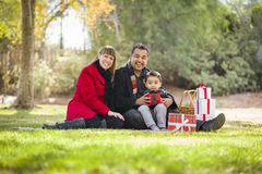 Happy Mixed Race Family Opening Christmas Gifts Royalty Free Stock Photography