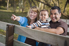 Happy Mixed Race Family Playing In The Park Royalty Free Stock Images
