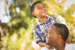 Happy Mixed Race Father and Son Playing Royalty Free Stock Photography