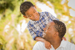 Happy Mixed Race Father and Son Playing Stock Photography