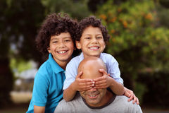 Happy mixed race father and sons Royalty Free Stock Photography
